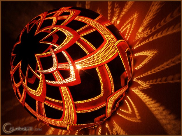 Using drills and cutters he covers gourd with intricate patterns by making  them their original fixtures, creating a dark amazing lighting effects.