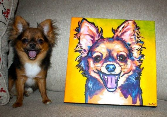 Adorable Animals Posing With Portraits of Themselves 001