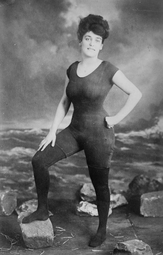Annette Kellerman promotes women's right to wear a fitted one-piece bathing suit, 1907. She was arrested for indecency